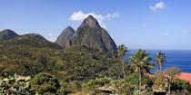 """<p>Mention the Caribbean, and most likely you immediately think of white-sand beaches with aquamarine waters. Mountains probably don't factor in, but that's just what the island of St. Lucia is known for: the <a href=""""https://www.tripadvisor.com/Attraction_Review-g147342-d150512-Reviews-Pitons-St_Lucia.html"""" rel=""""nofollow noopener"""" target=""""_blank"""" data-ylk=""""slk:twin peaks of the Pitons"""" class=""""link rapid-noclick-resp"""">twin peaks of the Pitons</a> — Gros Piton and Petit Peton. You can hike on and around both mountains. Better yet, take in the views from the comfort of your hotel room. </p>"""