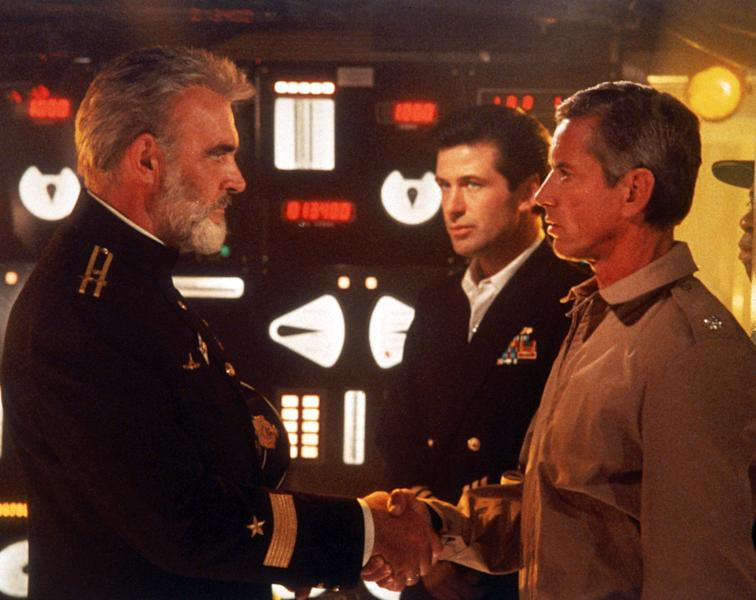 """FILE - This undated file image provided by Paramount Studios shows a scene from """"The Hunt for Red October"""" starring, from left, Sean Connery, Alec Baldwin and Scott Glenn. The film is based on the book by Tom Clancy. Clancy, the bestselling author of """"The Hunt for Red October"""" and other wildly successful technological thrillers, has died. He was 66. Penguin Group (USA) said Wednesday, Oct. 2, 2013, that Clancy died Tuesday in Baltimore. The publisher did not disclose a cause of death. (AP Photo/Paramount Studios)"""