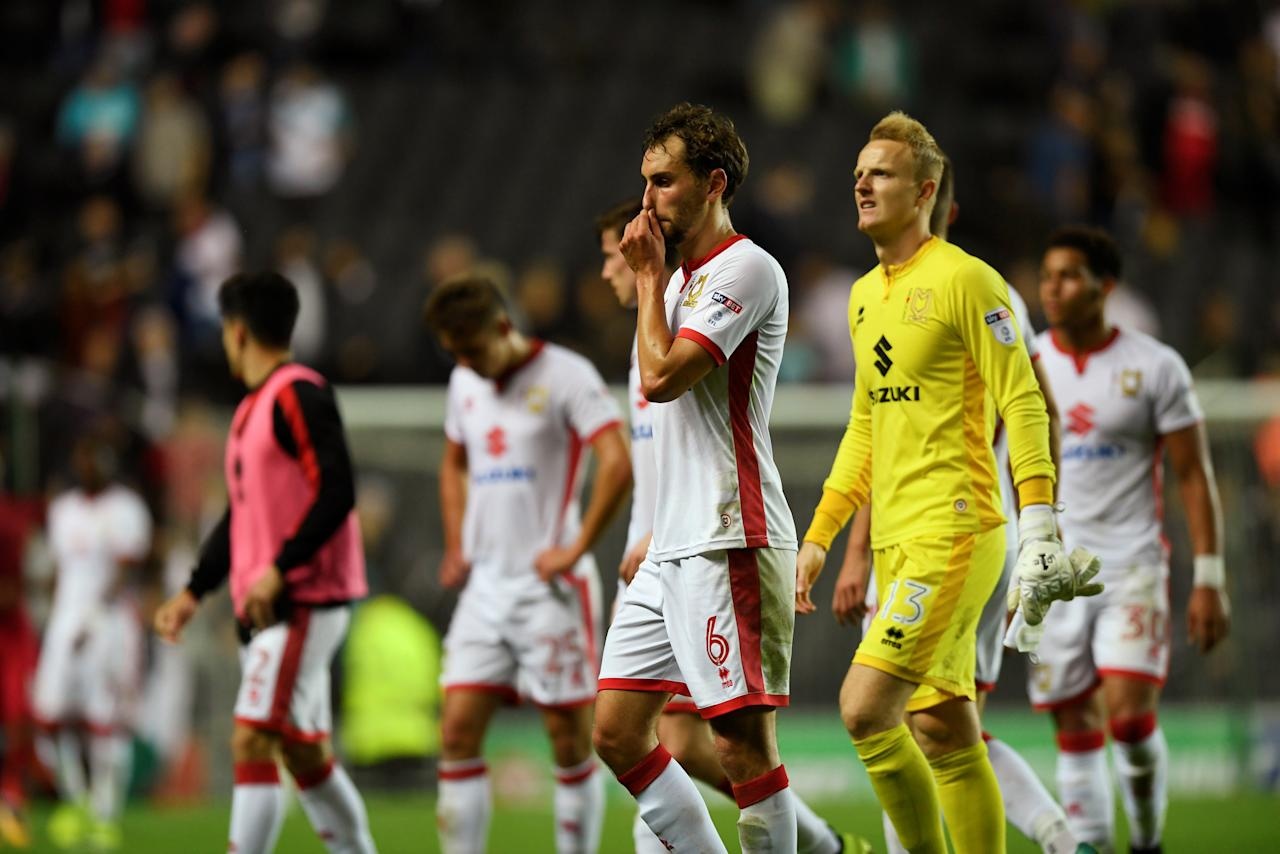 "Soccer Football - Carabao Cup Second Round - Milton Keynes Dons vs Swansea City - Milton Keynes, Britain - August 22, 2017   Milton Keynes Dons' Edward Upson, Wieger Sietsma and teammates look dejected after the match   Action Images via Reuters/Tony O'Brien     EDITORIAL USE ONLY. No use with unauthorized audio, video, data, fixture lists, club/league logos or ""live"" services. Online in-match use limited to 45 images, no video emulation. No use in betting, games or single club/league/player publications. Please contact your account representative for further details."