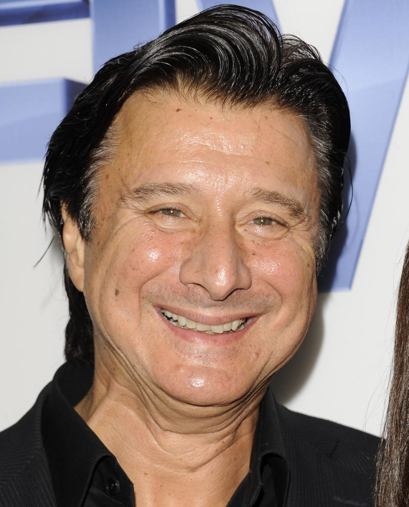 "FILE - In this Sept. 26, 2011 file photo, Steve Perry, former lead singer of the rock band Journey, arrives at  a premiere screening at Skylight SoHo in New York. Perry said though the band's songs -- including the soundtrack staple ""Don't Stop Believin'"" have experienced a resurgence in recent years, there's little chance of Perry rejoining the band and participating in what likely would be a lucrative tour.  (AP Photo/Evan Agostini, file)"