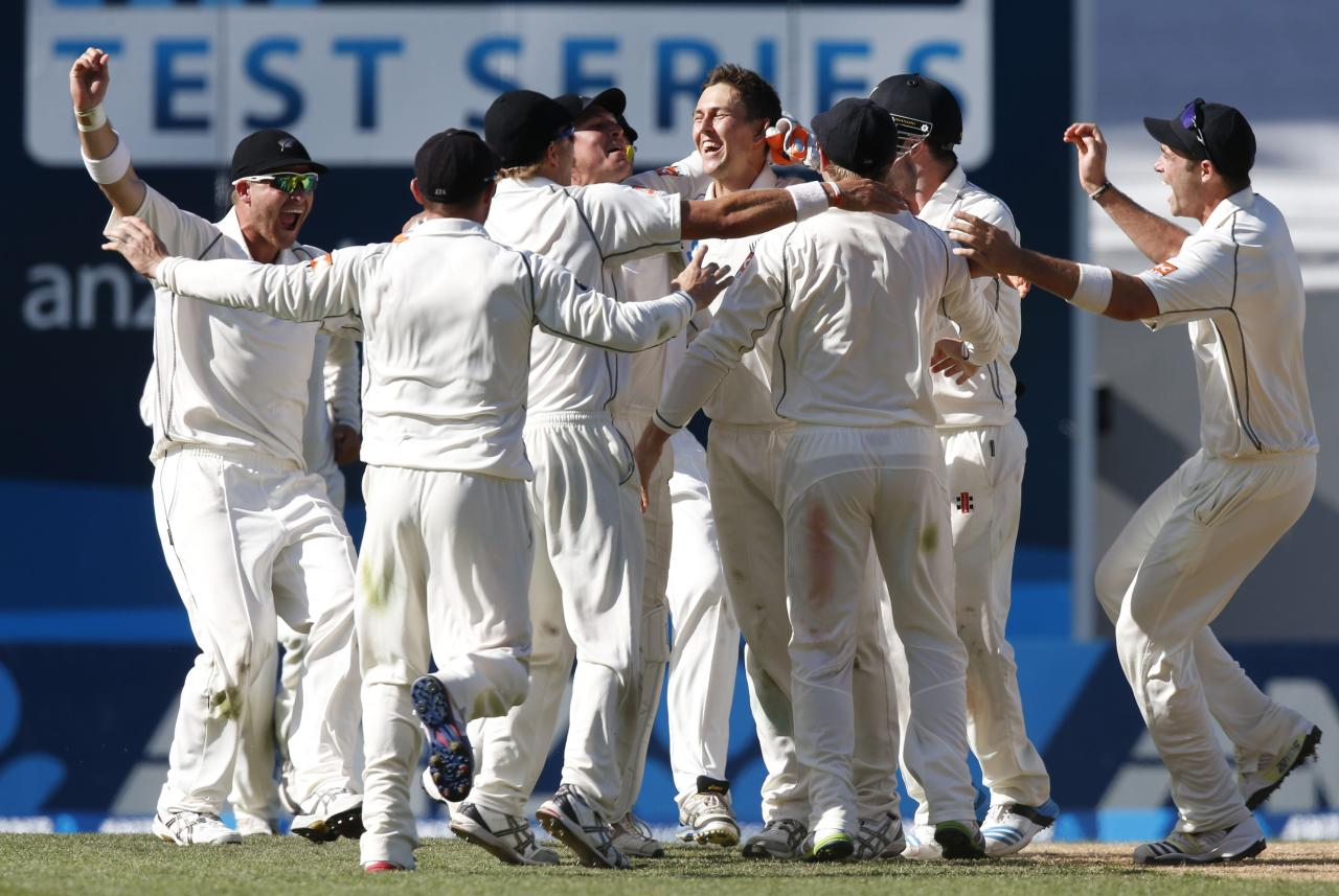 New Zealand celebrate winning the first international test cricket match against India at Eden Park in Auckland February 9, 2014. New Zealand won the match by 40 runs. REUTERS/Nigel Marple (NEW ZEALAND - Tags: SPORT CRICKET)