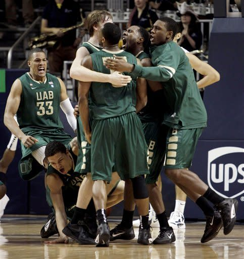 UAB players celebrate their last-second win over Rice in overtime of an NCAA college basketball game, Wednesday, Jan. 18, 2012, in Houston. UAB won 61-60. (AP Photo/Houston Chronicle, Brett Coomer) MANDATORY CREDIT