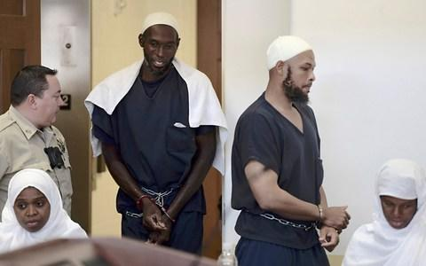 Defendants, from left, Hujrah Wahhaj, Lucas Morton, Siraj Wahhaj and Subbannah Wahhaj enter district court in Taos, New Mexico, on Monday - Credit: Albuquerque Journal