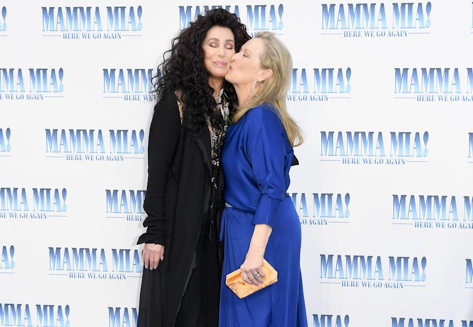 """Cher, left, and Meryl Streep attend the """"Mamma Mia! Here We Go Again"""" premiere in London in 2018."""