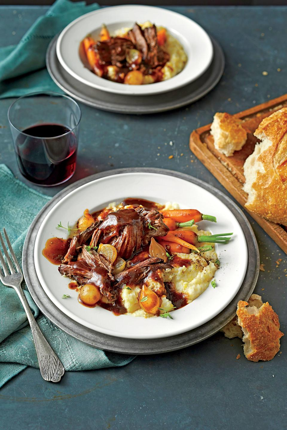 """<p><strong>Recipe: <a href=""""https://www.southernliving.com/syndication/beer-braised-pot-roast"""" rel=""""nofollow noopener"""" target=""""_blank"""" data-ylk=""""slk:Beer-Braised Pot Roast"""" class=""""link rapid-noclick-resp"""">Beer-Braised Pot Roast</a></strong></p> <p>This is no ordinary pot roast. First, it's rubbed with coffee. Then it simmers in dark stout beer and beef stock, yielding a deeply delicious gravy. Small carrots with tops and pearl onions elevate it further. Just be sure to pile the veggies on top of the beef after all other ingredients are in your cooker, so they'll cook perfectly and keep a vibrant color.</p>"""