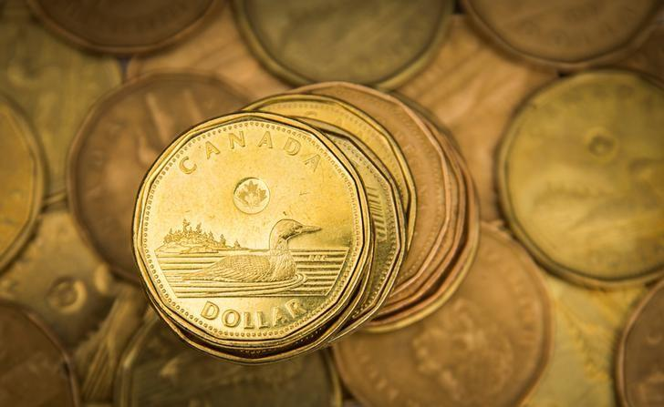 """FILE PHOTO: A Canadian dollar coin, commonly known as the """"Loonie"""", is pictured in this illustration picture taken in Toronto"""