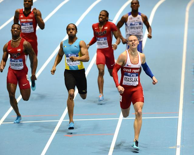 Pavel Maslak (R) wins the Men 400 m at the IAAF World Indoor Athletics Championships in the Ergo Arena in the Polish coastal town of Sopot, on March 8, 2014 (AFP Photo/Janek Skarzynski)