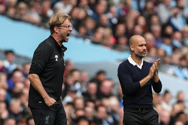 Jurgen Klopp, left, might not be too happy with Liverpool's Round of 16 Champions League matchup vs. Bayern Munich. Pep Guardiola and Manchester City, meanwhile, fared much better in the draw. (Getty)
