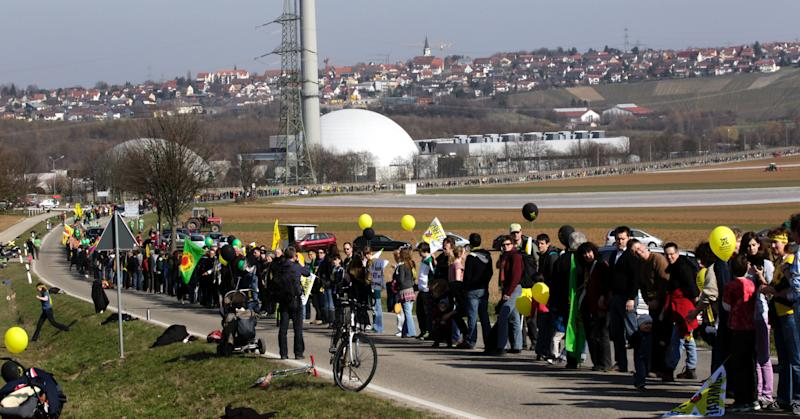 Participants of an anti nuclear demonstration form a human chain in front of the nuclear power plant in Neckarwestheim, southern Germany Satuday March 12, 2011. Thousands of people have demonstrated against plans to extend the life of Germany's nuclear power stations as an explosion at a Japanese plant gives new fuel to a long-running squabble over the technology's future.  (AP Photo/dapd/Michael Latz)