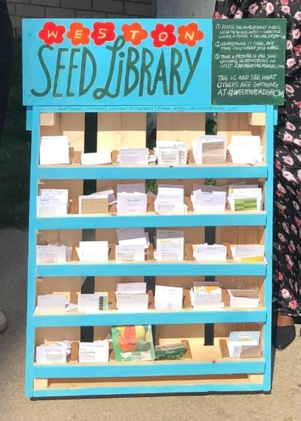 The Weston Seed Library contains packets of seeds organized on shelves. It is located at The Community Place Hub, 1765 Weston Rd. 'Everything is free but take only what you need,' it reads.