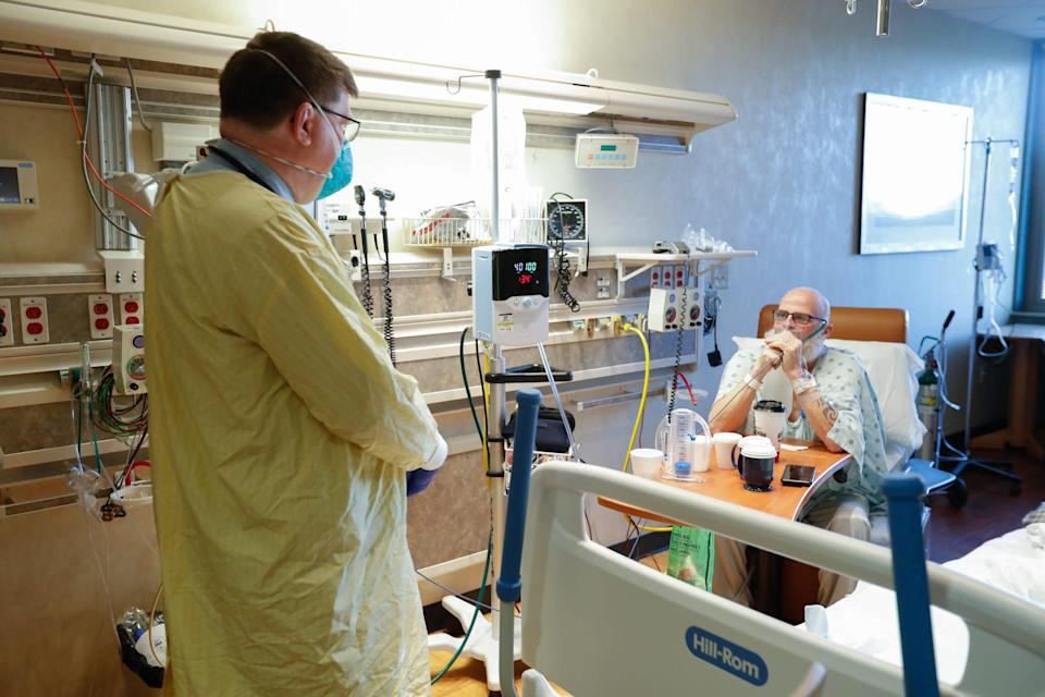Robert M. Klinestiver, MD, the Medical Director of Pulmonary and Respiratory Services for Hancock Regional Hospital, checks on his Covid-19 patient, Mark Green, on Friday, Sept. 24, 2021, at Hancock Regional Hospital, Greenfield Ind.