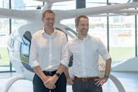 """Volocopter CEO Florian Reuter (right) and Skyports managing director Duncan Walker standing next to a prototype two-seat Volocopter electric air taxi at the VoloPort press conference in Singapore on 21 October 2019. Read our story: <a href=""""https://bit.ly/2Q5SIfk"""" rel=""""nofollow noopener"""" target=""""_blank"""" data-ylk=""""slk:https://bit.ly/2Q5SIfk"""" class=""""link rapid-noclick-resp"""">https://bit.ly/2Q5SIfk</a> (PHOTO: Dhany Osman / Yahoo News Singapore)"""