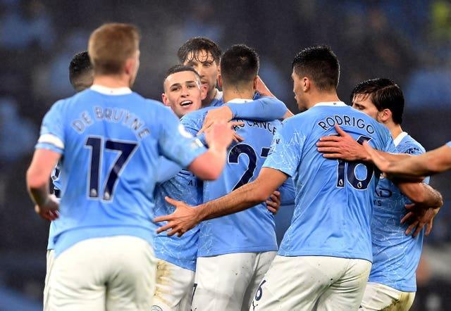 Phil Foden (centre) scored as City beat Brighton 1-0 on Wednesday