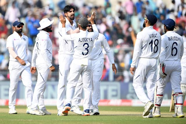 India's bowler Ishant Sharma (3rd L) celebrates after taking the wicket of Bangladesh's batsman Imrul Kayes during the first day of the second Test cricket match of a two-match series between India and Bangladesh at The Eden Gardens cricket stadium in Kolkata on November 22, 2019. (Photo by Dibyangshu SARKAR / AFP) / IMAGE RESTRICTED TO EDITORIAL USE - STRICTLY NO COMMERCIAL USE