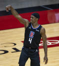 Los Angeles Clippers guard Rajon Rondo (4) watches a shot during the first quarter of an NBA game against the Houston Rockets on Friday, May 14, 2021, in Houston. (Mark Mulligan/Houston Chronicle via AP)