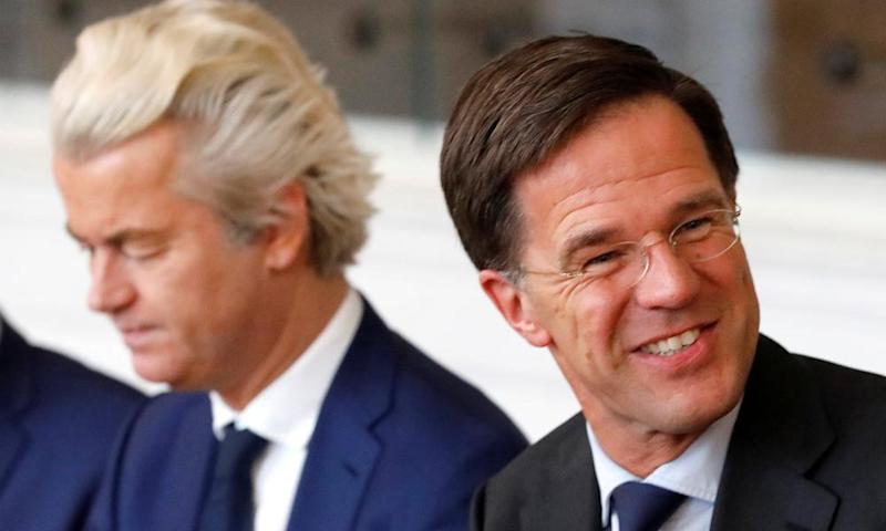 Dutch prime minister Mark Rutte, right, and far-right politician Geert Wilders at a meeting in parliament after the general election.