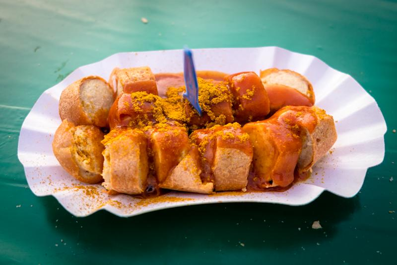 Close-Up Of Currywurst Served In Paper Plate On Table