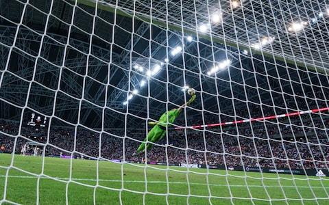 Wojciech Szczesny grasps at thin air at the Singapore National Stadium - Credit: GETTY IMAGES
