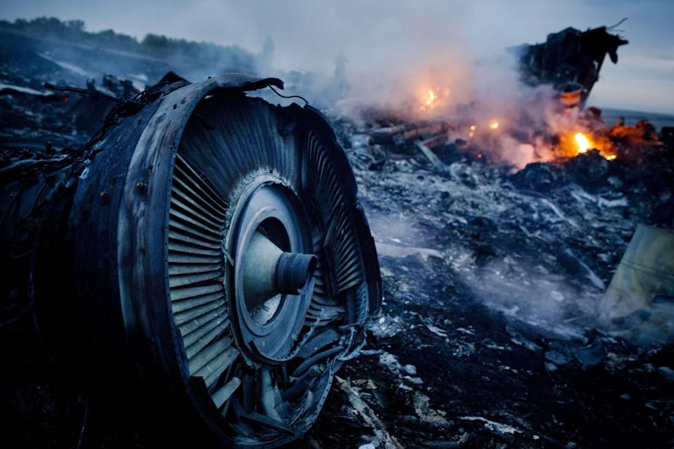 "<div class=""inline-image__caption""><p>Debris from Malaysia Airlines Flight 17 is shown smoldering in a field July 17, 2014 in Grabovo, Ukraine near the Russian border. Flight 17, on its way from Amsterdam to Kuala Lumpur and carrying 295 passengers and crew, is believed to have been shot down by a surface-to-air missile, according to U.S. intelligence officials and Ukrainian authorities quoted in published reports. The area is under control of pro-Russian militias. </p></div> <div class=""inline-image__credit"">Pierre Crom/Getty</div>"
