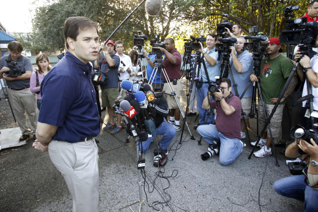 Republican U.S. Senate candidate Marco Rubio talks to reporters after casting his ballot in Miami November 2, 2010. REUTERS/Hans Deryk