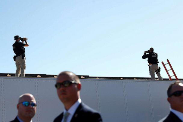 PHOTO: United States Secret Service Agents scan the surrounding area of the international border during President Donald Trump's visit to a section of the U.S.-Mexico border wall in Otay Mesa, Calif., Sept. 18, 2019. (Tom Brenner/Reuters)