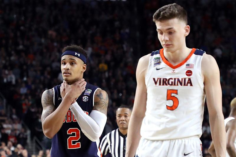 MINNEAPOLIS, MINNESOTA - APRIL 06: Bryce Brown #2 of the Auburn Tigers gestures as Kyle Guy #5 of the Virginia Cavaliers looks on in the second half during the 2019 NCAA Final Four semifinal at U.S. Bank Stadium on April 6, 2019 in Minneapolis, Minnesota. (Photo by Streeter Lecka/Getty Images)