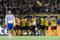 Manchester's Luke Shaw looks dejected as Young Boys celebrate after scoring during of the Champions League group F soccer match between BSC Young Boys and Manchester United, at the Wankdorf stadium in Bern, Switzerland, Tuesday, Sept. 14, 2021. (Alessandro della Valle/Keystone via AP)
