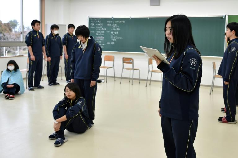 Students from Fukushima rehearse a play dealing with the stigma they met as evacuees from the tsunami disaster that triggered a nuclear panic