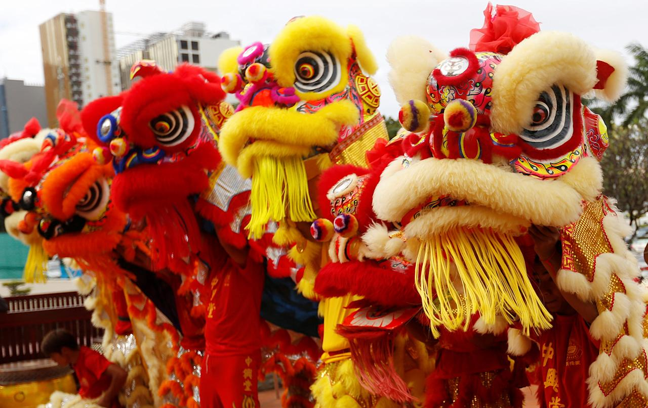 men perform a lion dance ahead of the chinese lunar new year in - Chinese Lunar New Year