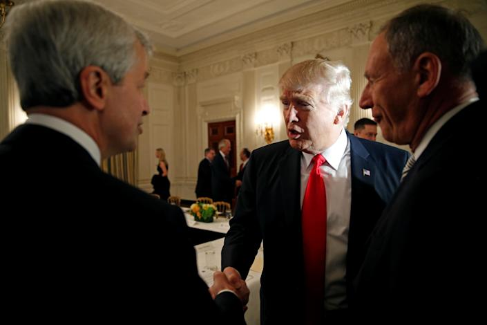 U.S. President Donald Trump shakes hands with JPMorgan Chase & Co CEO Jamie Dimon (L) as he hosts a strategy and policy forum with chief executives of major U.S. companies at the White House in Washington February 3, 2017.  REUTERS/Kevin Lamarque