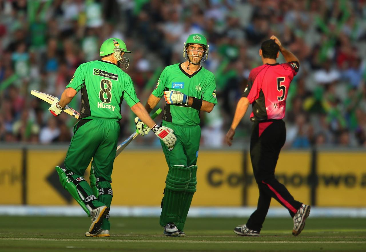 MELBOURNE, AUSTRALIA - DECEMBER 21:  Glenn Maxwell of the Stars is congratulated by David Hussey after he hit a boundary during the Big Bash League match between the Melbourne Stars and the Sydney Sixers at Melbourne Cricket Ground on December 21, 2012 in Melbourne, Australia.  (Photo by Scott Barbour/Getty Images)