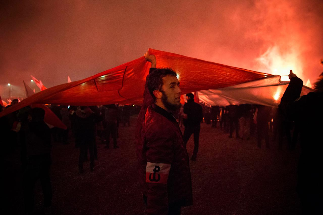 <p>Man holds big Polish flag during Independence March in Warsaw, Poland on Nov. 11, 2017. (Photo: Maciej Luczniewski/NurPhoto via Getty Images) </p>