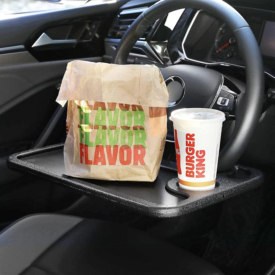<p>This <span>Cutequeen Car Laptop/Eating Wheel Desk</span> ($12) will come in handy - just make sure you're parked!</p>