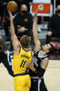 Indiana Pacers forward Domantas Sabonis (11) shoots against Los Angeles Clippers center Ivica Zubac during the first quarter of an NBA basketball game, Sunday, Jan. 17, 2021, in Los Angeles. (AP Photo/Ashley Landis)