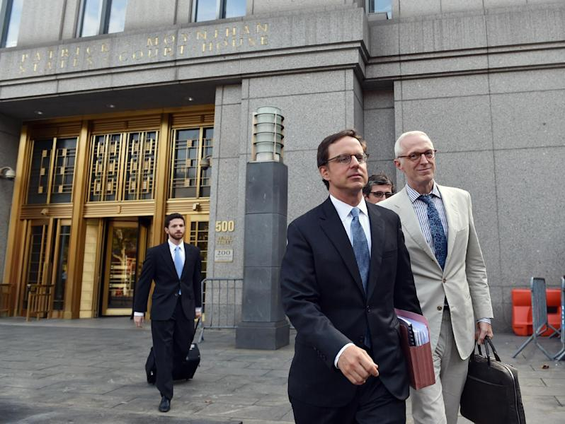 Argentina's government attorney Carmine Boccuzzi (C) and other lawyers leave the US Federal Courthouse August 21, 2014 in New York (AFP Photo/Stan Honda)