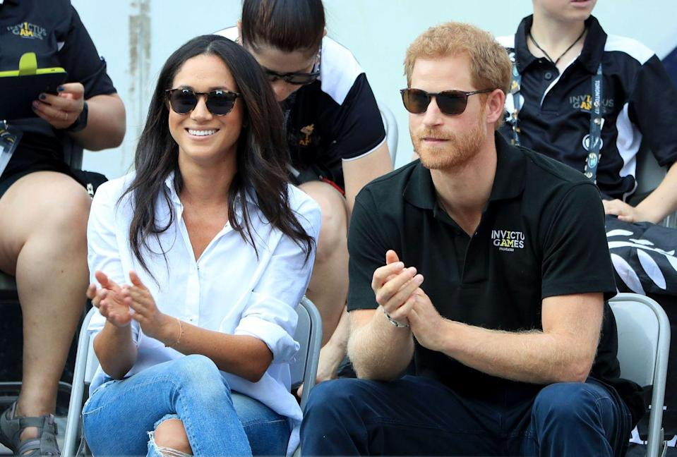 """<p><a href=""""https://www.townandcountrymag.com/society/a13970045/misha-nonoo-meghan-markle-prince-harry-matchmaker/"""" rel=""""nofollow noopener"""" target=""""_blank"""" data-ylk=""""slk:Nonoo"""" class=""""link rapid-noclick-resp"""">Nonoo</a> and the Duchess have been close friends for years. Meghan wore the designer's now-famous Husband Shirt to <a href=""""https://www.townandcountrymag.com/society/tradition/a12466469/meghan-markle-prince-harry-hold-hands-invictus-games/"""" rel=""""nofollow noopener"""" target=""""_blank"""" data-ylk=""""slk:her first public appearance with Harry at the Invictus Games"""" class=""""link rapid-noclick-resp"""">her first public appearance with Harry at the Invictus Games</a> in 2017.</p><p><a class=""""link rapid-noclick-resp"""" href=""""https://go.redirectingat.com?id=74968X1596630&url=https%3A%2F%2Fmishanonoo.com%2Fproducts%2Fthe-husband-shirt-white&sref=https%3A%2F%2Fwww.elle.com%2Ffashion%2Fshopping%2Fg36477134%2Fmeghan-markle-white-button-down-shirts%2F"""" rel=""""nofollow noopener"""" target=""""_blank"""" data-ylk=""""slk:Shop Now"""">Shop Now</a></p>"""