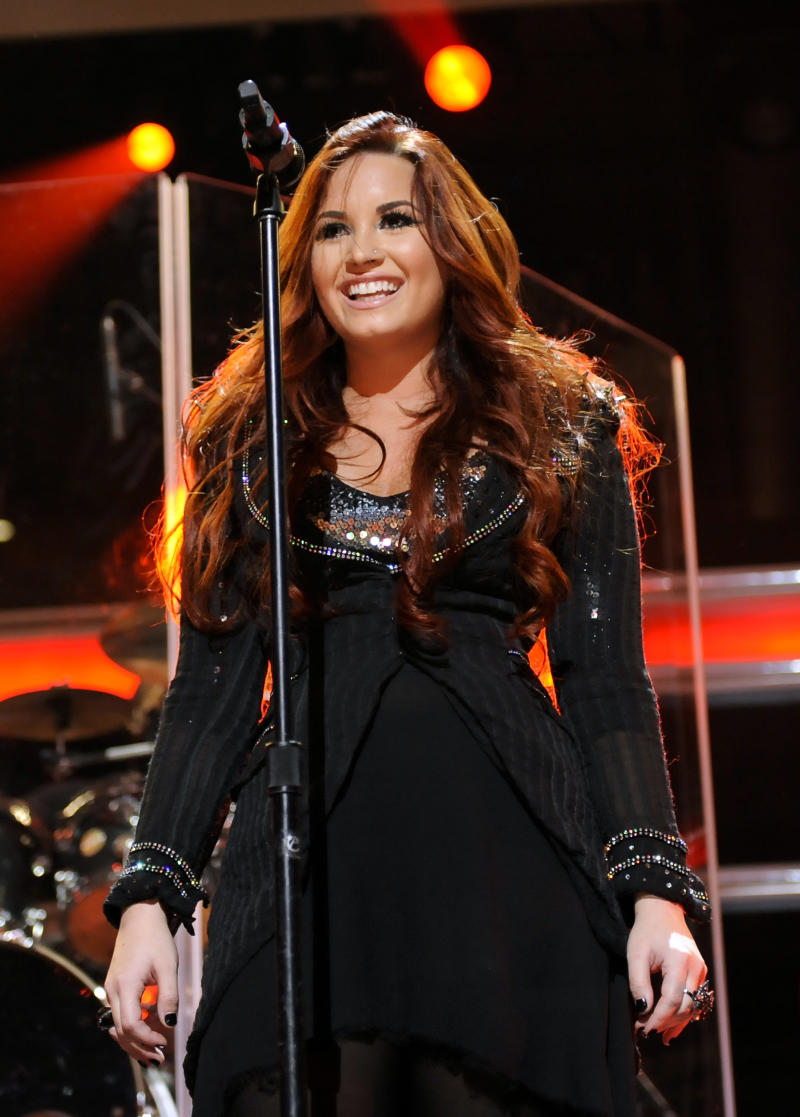 Singer Demi Lovato performs at Z100's Jingle Ball concert at Madison Square Garden on Friday, Dec. 9, 2011 in New York. (AP Photo/Evan Agostini)