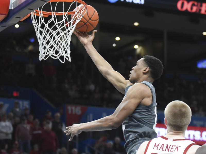 Mississippi State guard Robert Woodard (12) goes up for a shot over Oklahoma forward Brady Manek (35) during the second half of an NCAA college basketball game in Oklahoma City, Saturday, Jan. 25, 2020. (AP Photo/Kyle Phillips)