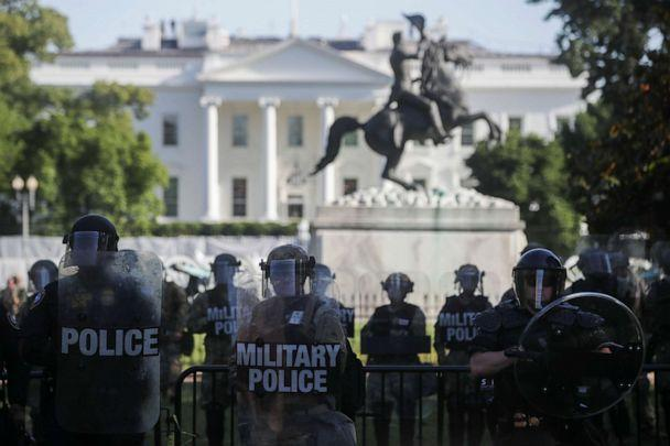 PHOTO: DC National Guard military police officers look on as demonstrators rally near the White House against the death in Minneapolis police custody of George Floyd, in Washington, D.C., June 1, 2020. (Jonathan Ernst/Reuters)