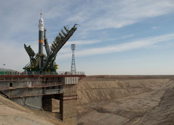 Large gantry mechanisms on either side of the Soyuz TMA-08M spacecraft are raised into position to secure the rocket at the launch pad on Tuesday, March 26, 2013 at the Baikonur Cosmodrome in Kazakhstan. Liftoff is set for March 28 EDT (March 2