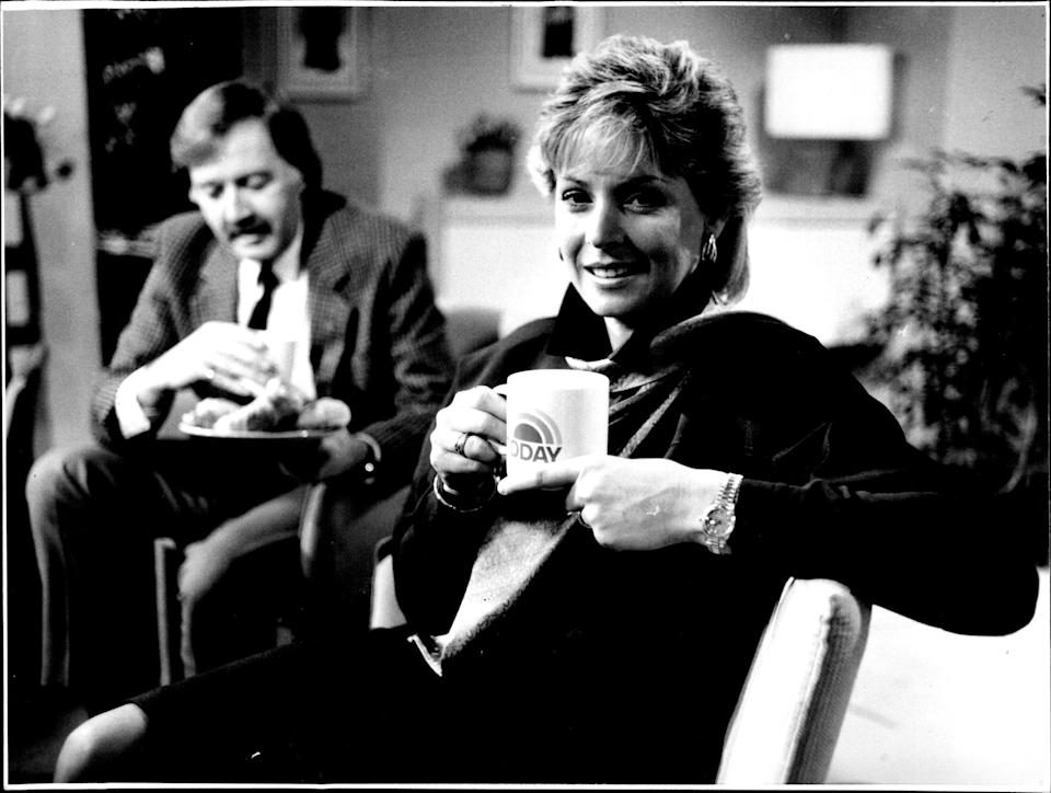 Liz Hayes photographed in Today studio on Channel 9, while George Negus looks on. June 15, 1988.