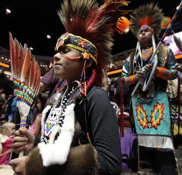 Native American and indigenous dancers prepare for the grand entry during the 29th Annual Gathering of Nations in Albuquerque, N.M., on Friday, April 27, 2012. The event draws more than 3,000 dancers and singers and tens of thousands of spectators for three days of competitions and the crowning of Miss Indian World. (AP Photo/Susan Montoya Bryan)