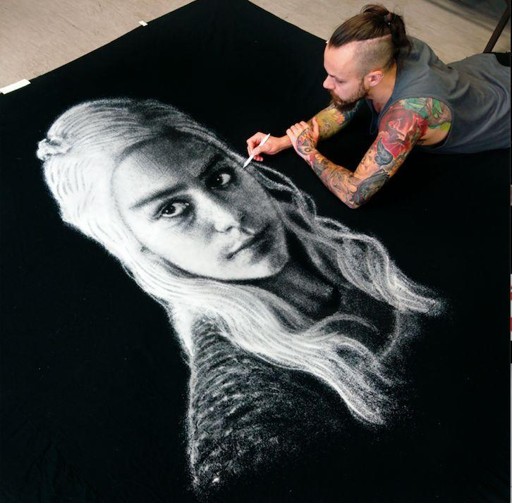 Dino Tomic of Croatia creates detailed pictures by spreading kitchen salt onto a black background. He carefully sprinkles the salt onto a giant canvas from a plastic bottle or a paper cone and uses his fingers to add any finishing touches.