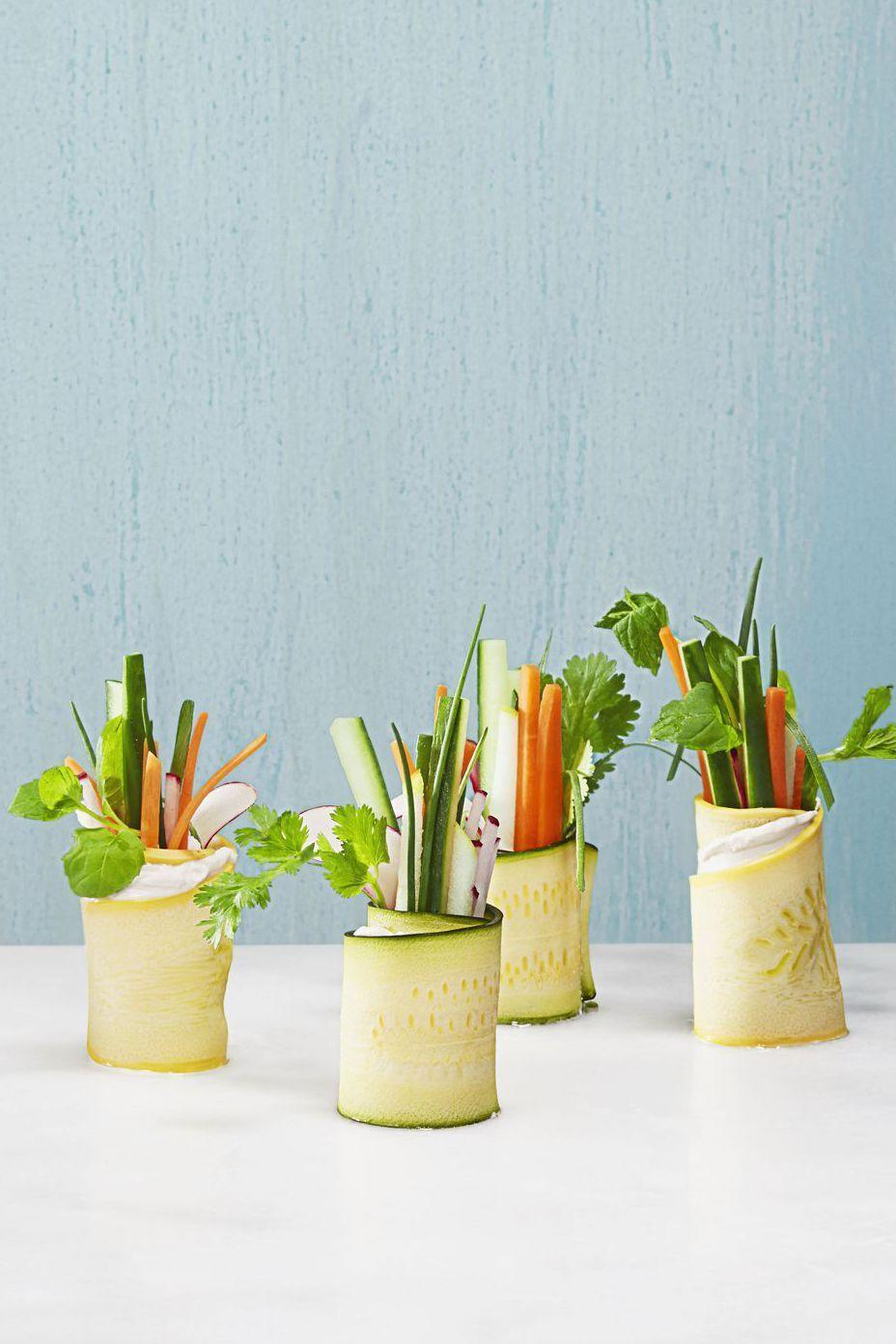 """<p>Wrap up your garden's bounty in wide zucchini or squash ribbons for a veggie-filled appetizer. </p><p><em><a href=""""https://www.goodhousekeeping.com/food-recipes/party-ideas/how-to/a33054/how-to-make-veggie-rolls/"""" rel=""""nofollow noopener"""" target=""""_blank"""" data-ylk=""""slk:Get the recipe for Summer Veggie Rolls »"""" class=""""link rapid-noclick-resp"""">Get the recipe for Summer Veggie Rolls » </a></em></p>"""