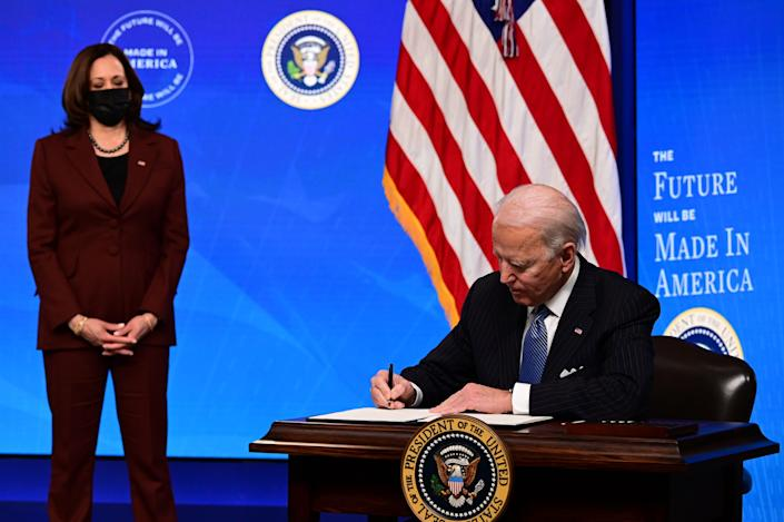 """<p>President Joe Biden with Vice President Kamala Harris signs a """"Made in America"""" Executive Order, to increase the amount of federal spending that goes to US companies</p> (Getty)"""