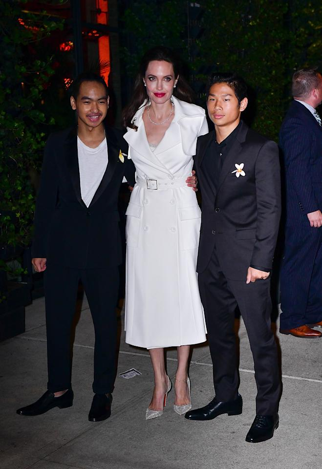 <p>Following an outfit change, Angelina and her big boys, Maddox and Pax, hit the after-party for the movie at Jams in NYC. (Photo: James Devaney/GC Images) </p>