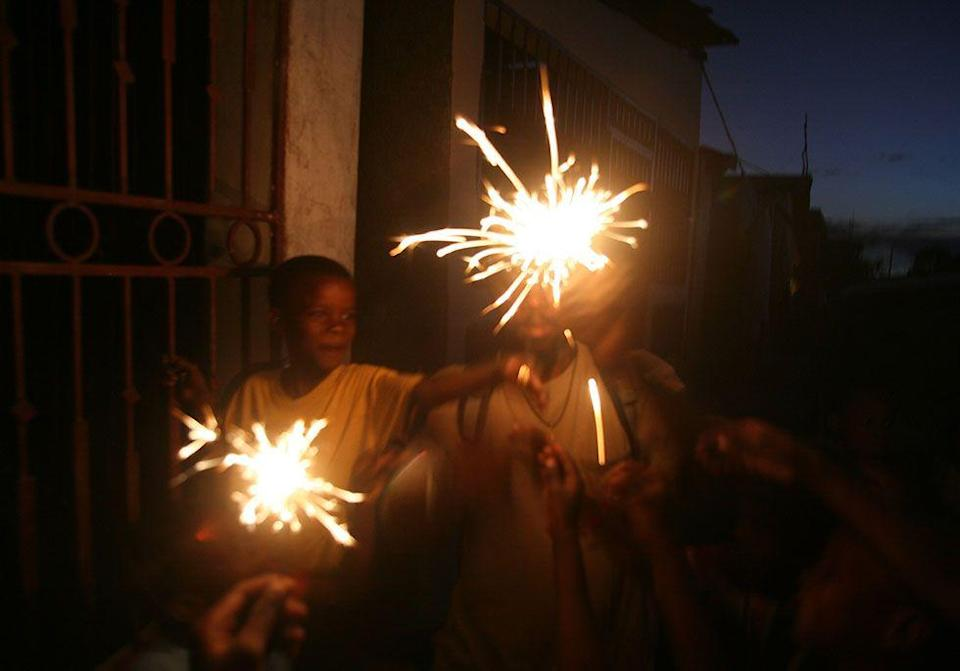 """<p>Haitian children wait until nightfall on Christmas Eve to light up <span class=""""redactor-unlink"""">Pi detwal (translated as """"rain of stars"""")</span> which are sparklers or other fireworks. </p>"""