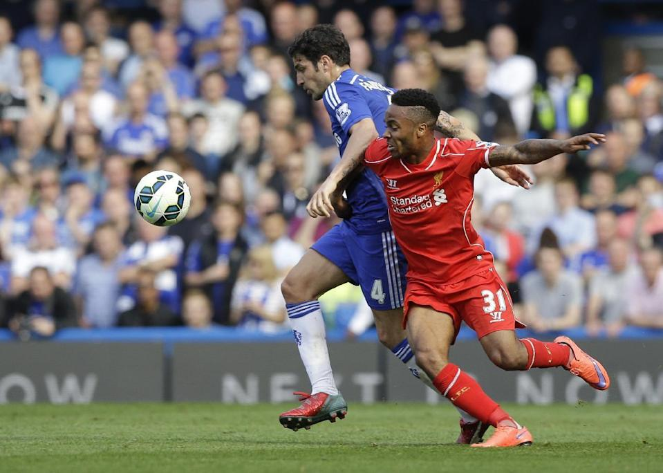 "FILE - In this Sunday, May 10, 2015 file photo, Chelsea's Cesc Fabregas, left, vies for the ball with Liverpool's Raheem Sterling during their English Premier League soccer match between Chelsea and Liverpool at Stamford Bridge stadium in London. England international Raheem Sterling has completed his big-money move to Manchester City from Liverpool. The 20-year-old, who will wear the number seven shirt, has become the club's record signing and the most expensive English footballer after sealing a move which will be worth up to 49million. A statement released on the club's official website, www.mcfc.co.uk, said: ""Manchester City are delighted to announce Raheem Sterling has joined the club on a five-year deal. (AP Photo/Matt Dunham, File)"
