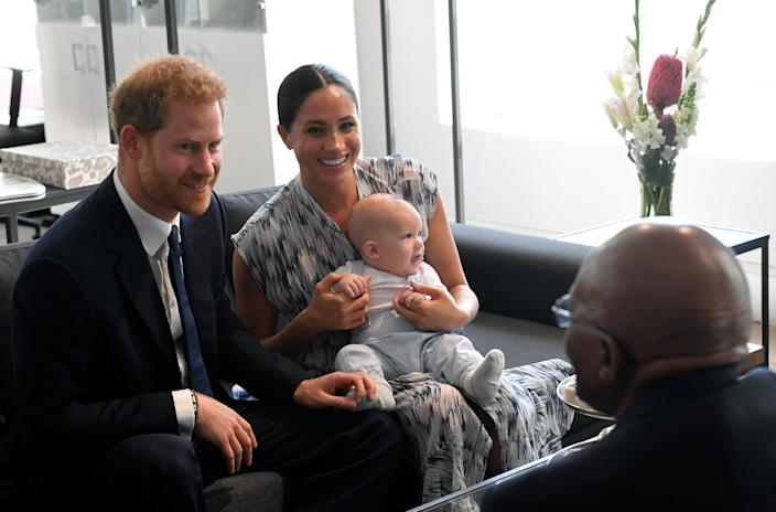 Britain's Prince Harry and his wife Meghan, Duchess of Sussex, holding their son Archie, meet Archbishop Desmond Tutu at the Desmond & Leah Tutu Legacy Foundation in Cape Town, South Africa, September 25, 2019. REUTERS/Toby Melville/Pool