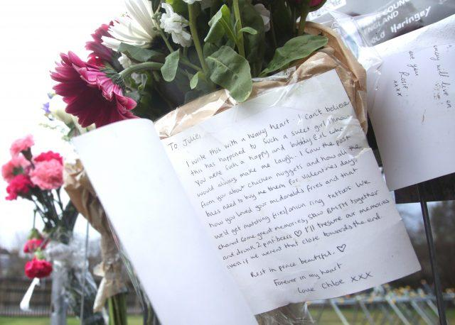 A message written on a card left in tribute to Iuliana Tudos (Yui Mok/PA)